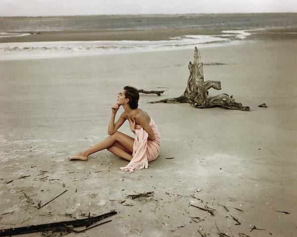 Model Wrapped In A Pink Towel On The Beach Art Print