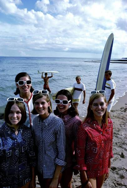 Group Of People Photograph - Models And Surfers On A Beach by William Connors
