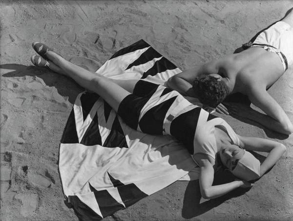 Lying Down Photograph - Models Lying On A Beach by George Hoyningen-Huene