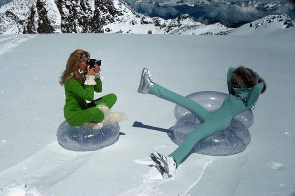 Blue Photograph - Models On Plastic Chairs With Snow In Switzerland by Arnaud de Rosnay