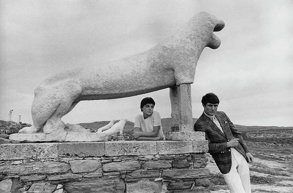 Photograph - Models Posing By A Sculpture Of A Lion by Leonard Nones