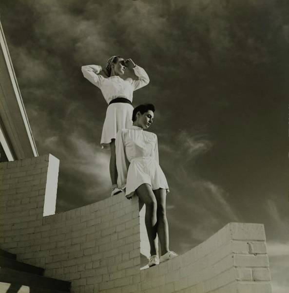 Wall Art - Photograph - Models Standing On A Brick Wall by Toni Frissell