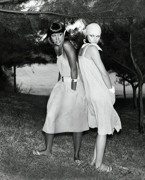 Photograph - Models Wearing Dresses Under Trees by Kourken Pakchanian