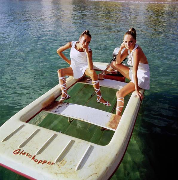 Wall Art - Photograph - Models Wearing White Dresses On A Motorboat by Arnaud de Rosnay