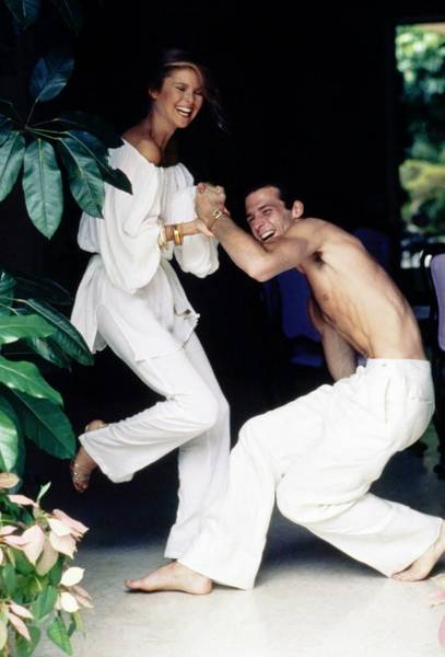 Christie Brinkley Photograph - Models Wearing White While Laughing by Arthur Elgort