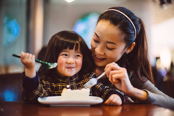 Mom & Toddler Girl Having Cake Joyfully In Cafe Art Print by images by Tang Ming Tung
