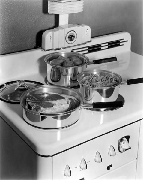 Beaver Photograph - Monarch Stove Top With Dinner by Underwood Archives