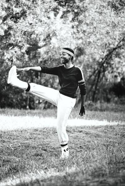 Exercise Photograph - Monica Kaufman Stretching In Sports Wear by William Connors