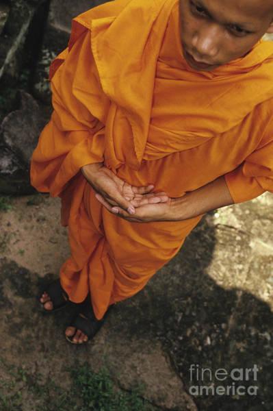 Phnom Penh Wall Art - Photograph - Monk In Saffron Robes Cambodia by Ryan Fox