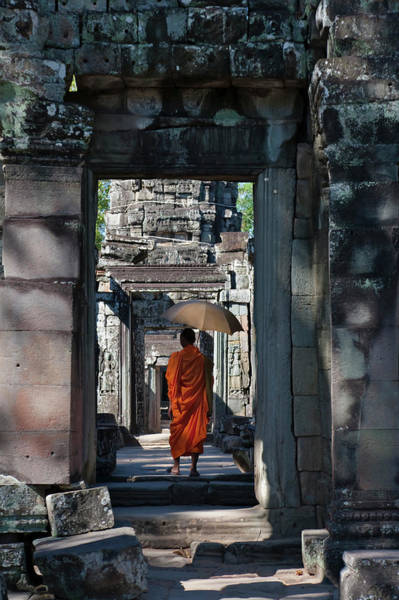 Angkor Wall Art - Photograph - Monk With Buddhist Statues In Banteay by Keren Su