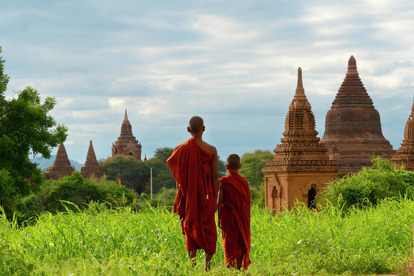 Bagan Photograph - Monks With Ancient Temples And Pagodas by Keren Su