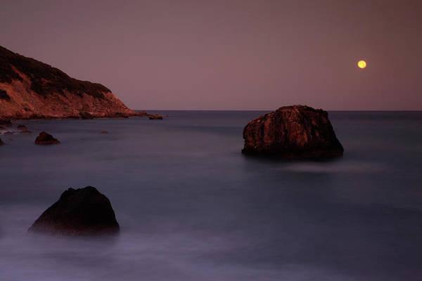 Setting Photograph - Moon Setting Over Rocks At Dawn At by Max Paoli