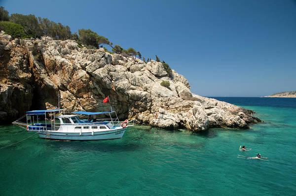 Snorkel Photograph - Moored Boat With Tourists Swimming And by Olivier Cirendini