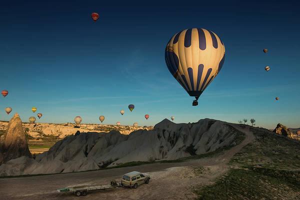 Cappadocia Photograph - Morning Balloon Launch At Cappadocia by Coolbiere Photograph