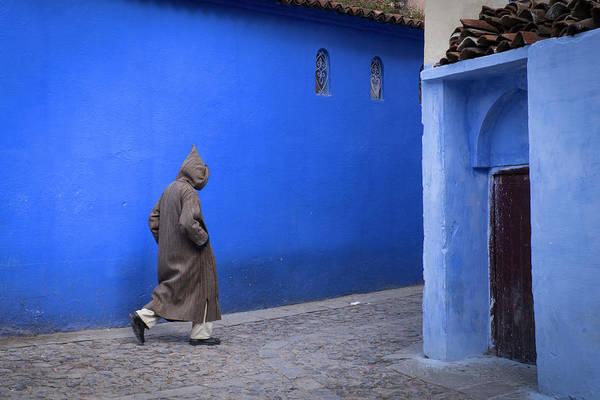 Chefchaouen Wall Art - Photograph - Morocco A Man Walks Through An Alley by Brenda Tharp