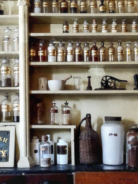 Photograph - Mortar And Pestle And Bottles On Shelves by Susan Savad