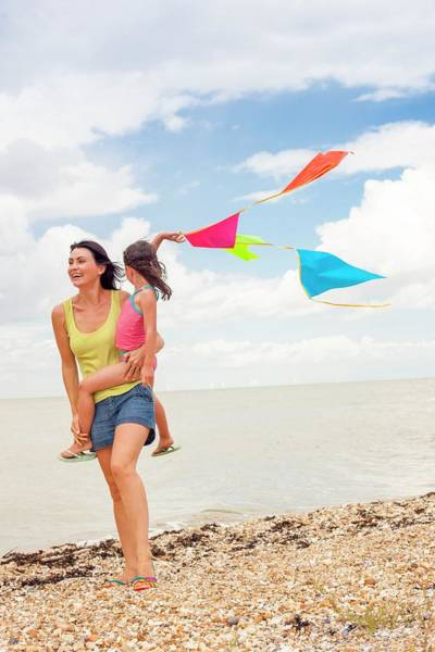Wall Art - Photograph - Mother And Daughter On Beach by Ian Hooton