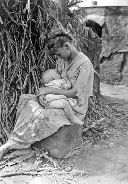 Appearance Photograph - Mother Breast Feeding A Baby by Underwood Archives