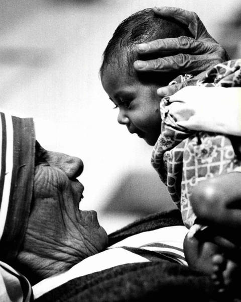 Wall Art - Photograph - Mother Teresa Holds Baby by Retro Images Archive
