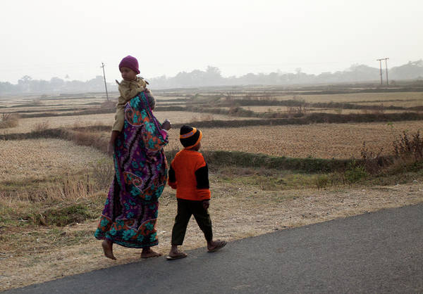Sweater Photograph - Mother With Her Two Babies Walking by Partha Pal