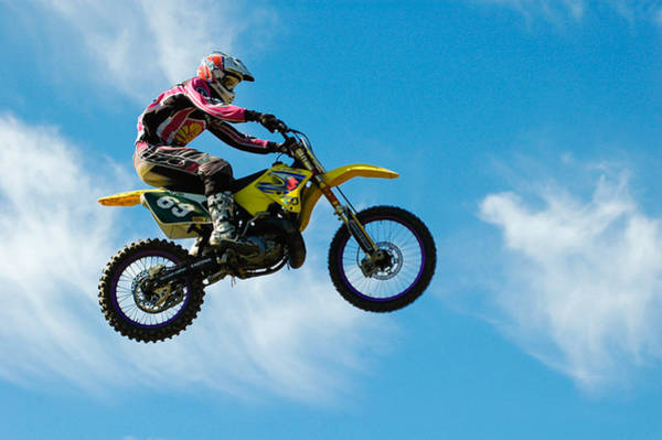 Photograph - Motocross Rider Jumping High - Blue Sky by Matthias Hauser