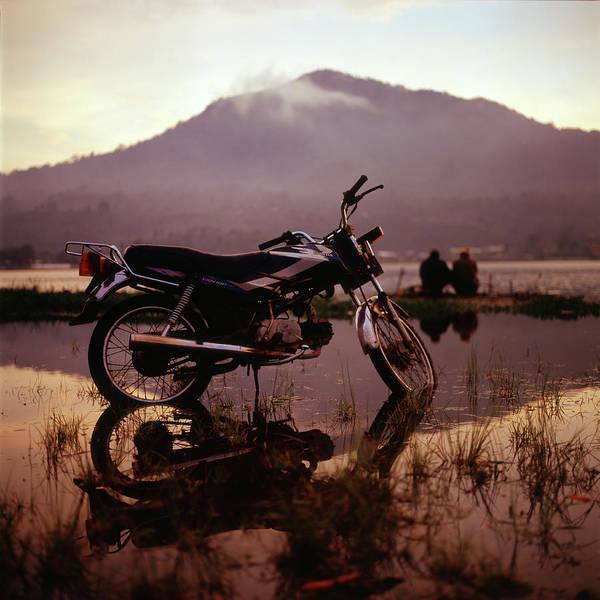 Wall Art - Photograph - Motorbike And Fisherman By Lake by Vsevolod Vlasenko