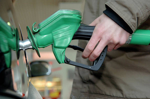 Hand Pump Photograph - Motorist Filling His Petrol Tank by Lawrence Lawry/science Photo Library