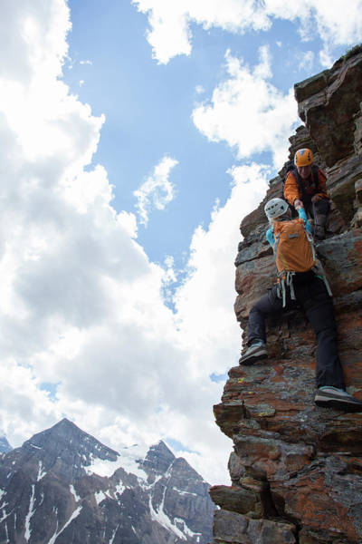 Wall Art - Photograph - Mountain Guide Assists Woman Climber by Philip & Karen Smith / TFA