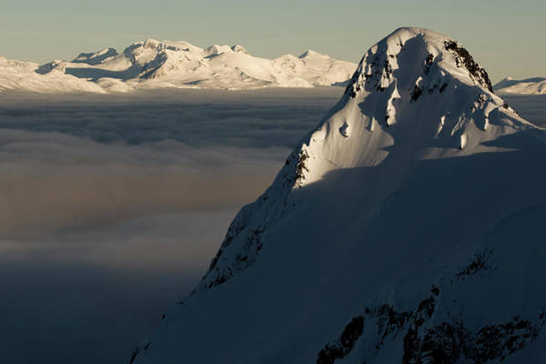 Alpen Glow Wall Art - Photograph - Mountain Peak With Valley Cloud Layer by Jeff Curtes