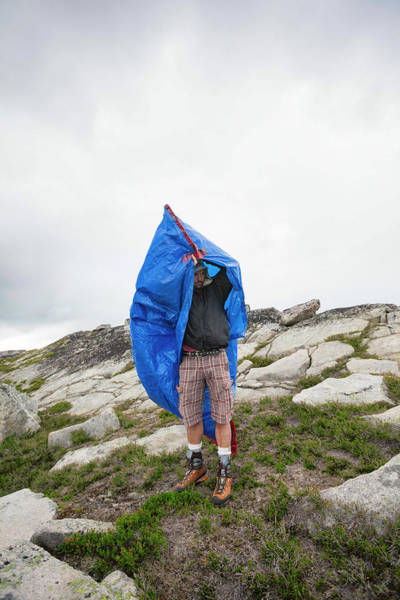 Wall Art - Photograph - Mountaineer Taking Shelter In Tarp Bag by Christopher Kimmel