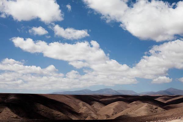Salar De Atacama Photograph - Mountains And Clouds In The Atacama by Michael Hanson