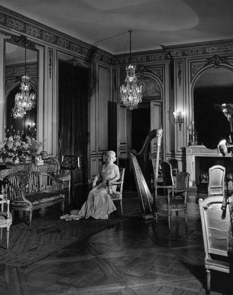 Photograph - Mrs. Cornelius Sitting In A Lavish Music Room by Cecil Beaton