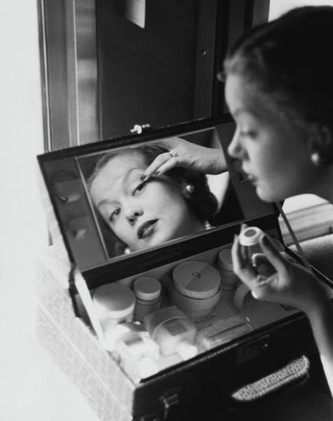 Apply Photograph - Mrs. Thomas Phipps Applying Make-up by Constantin Joffe