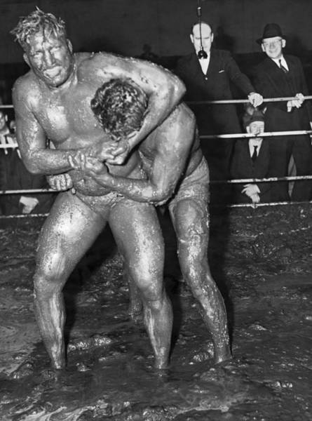 Wall Art - Photograph - Mud Wrestling Match by Underwood Archives
