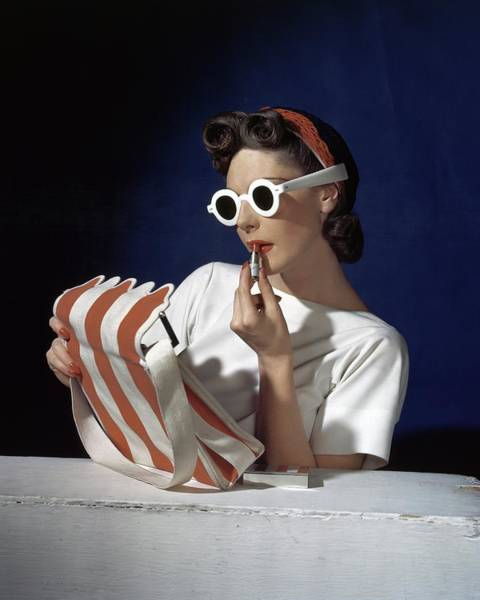 Make Up Photograph - Muriel Maxel Applying Lipstick by Horst P. Horst