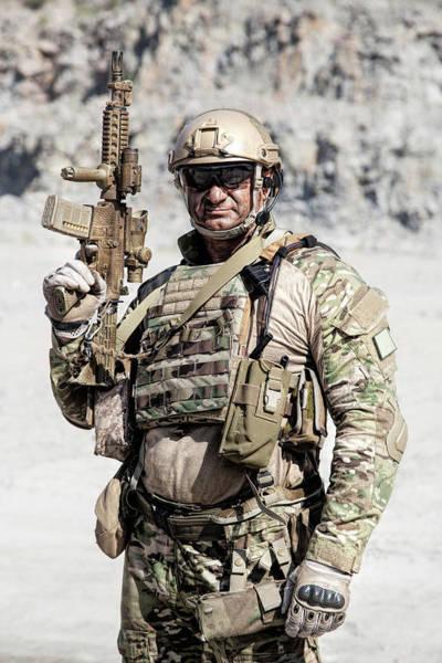 Wall Art - Photograph - Muscular Soldier In Field Uniform by Oleg Zabielin