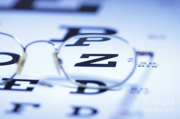 Photograph - Myopic Spectacles On Snellen Eye Chart by GIPhotoStock