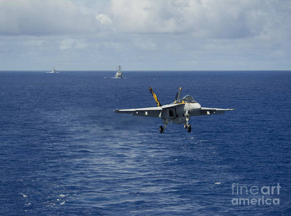 Uss George Washington Wall Art - Photograph - N Fa-18e Super Hornet Prepares To Make by Stocktrek Images
