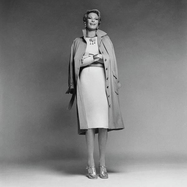 Chain Link Photograph - Nan Kempner Wearing A Coat And Dress by Francesco Scavullo