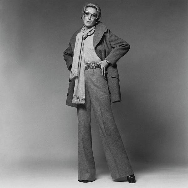 Chain Link Photograph - Nan Kempner Wearing A Pea Jacket And Trousers by Francesco Scavullo