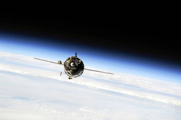 Photograph - Nasa Soyuz Spacecraft Approaches International Space Station by Rose Santuci-Sofranko