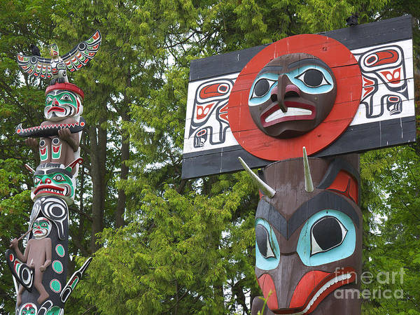 Photograph - Native American Totem Poles by Brenda Kean