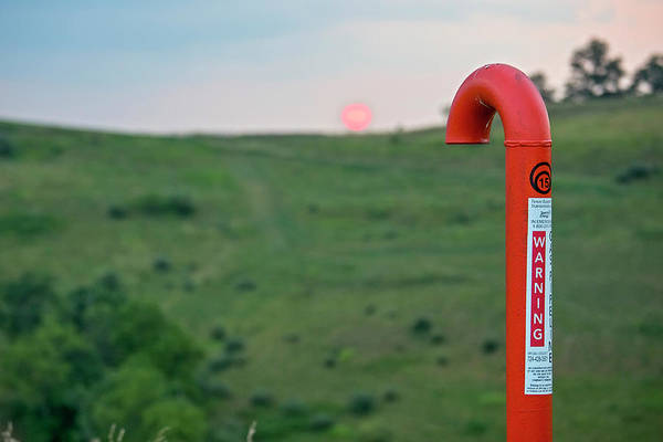 Fossil Fuel Photograph - Natural Gas Pipeline Marker At Sunset by Jim West