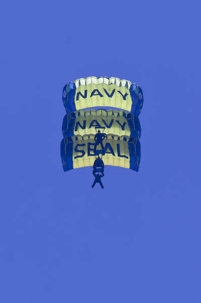 Photograph - Navy Seal Leap Frogs 3 Vertical Parachutes by Donna Corless