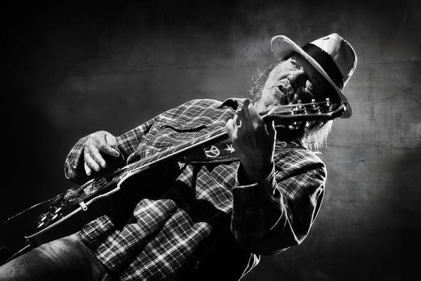 Neil Young Photograph - Neil Young On Guitar In Black And White  by Jennifer Rondinelli Reilly - Fine Art Photography