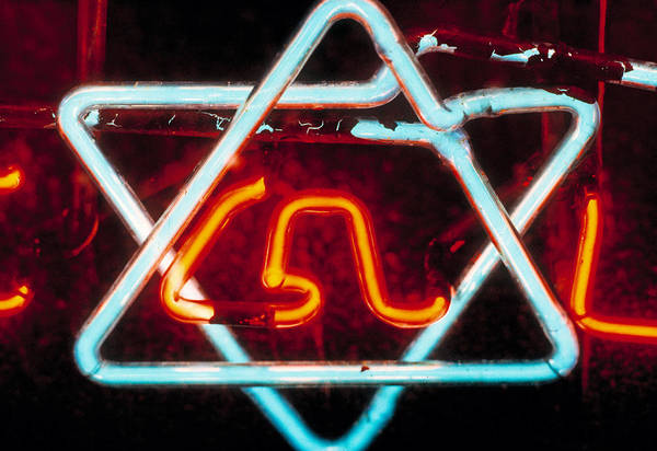 Wall Art - Photograph - Neon Jewish Star Symbol by Panoramic Images