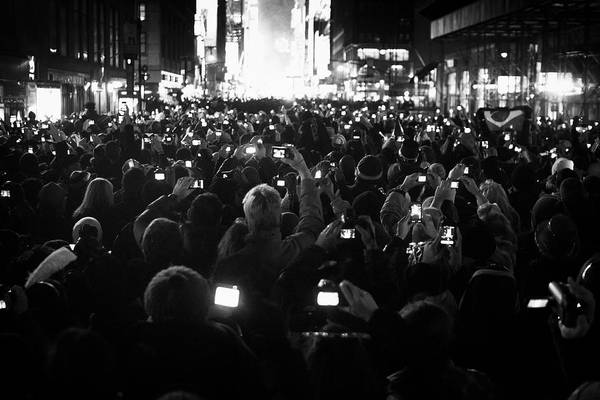 Photograph - New Years Eve Phones by Dave Beckerman