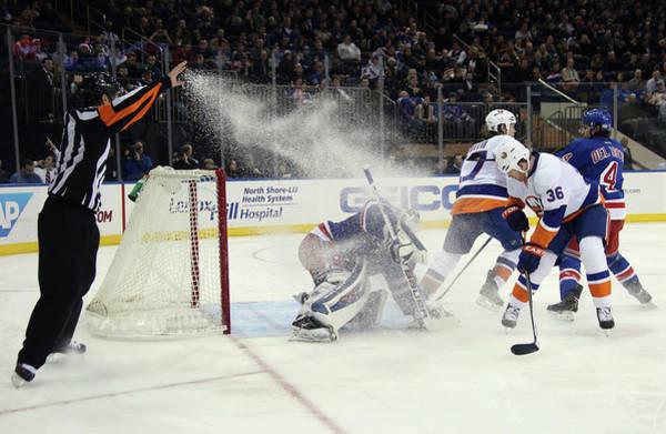 Dust Photograph - New York Islanders V New York Rangers by Bruce Bennett