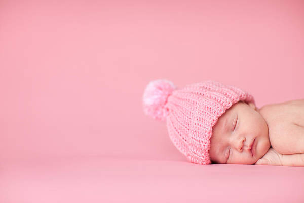 Newborn Baby Girl Sleeping Peacefully On Pink Background Art Print by Ideabug