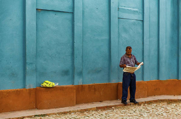 Trinidad Wall Art - Photograph - Newspaper Reading Banana Seller by Inge Schuster